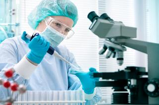 scientist-pipetting-microscope-diagnostics-clinical-PPE.jpg